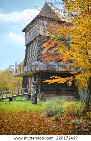 Small wooden bridge and tower. Autumn. Ukrainian Museum of Life and Architecture.