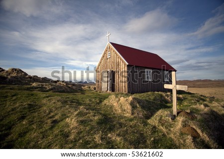 Small wooden church, spring, cloudy sky at background, Iceland
