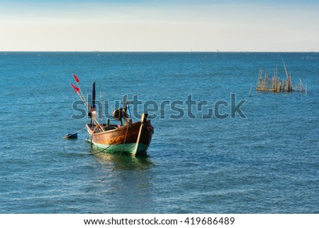 Small wooden fishing boat in Thailand
