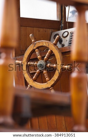 Small wooden fishing boat rudder of a classic form - stock photo
