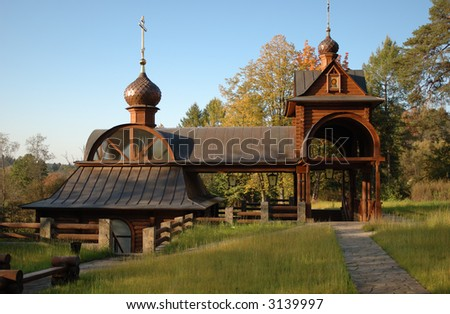 Small wooden font staying among autumn trees in the forest - stock photo