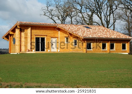 small wooden house in the countryside in french - stock photo