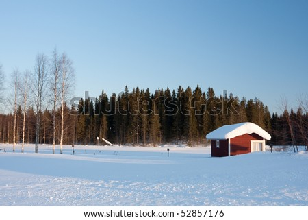 Small wooden house in winter. Finland. - stock photo