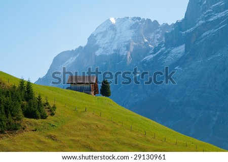 Small wooden house on the hill in Swiss Alps