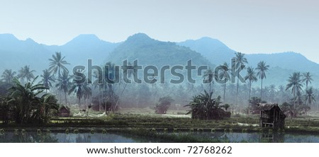 Small wooden house with fishing net in tropical forest near pond - stock photo
