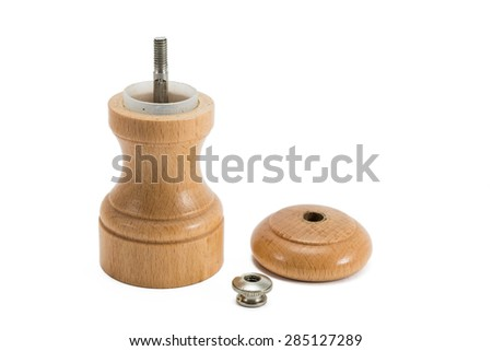 small wooden pepper grinder in three pieces - stock photo