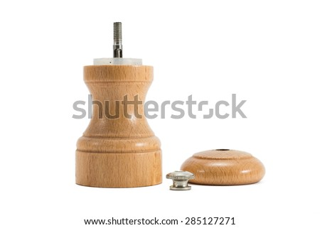 small wooden pepper grinder taken apart - stock photo