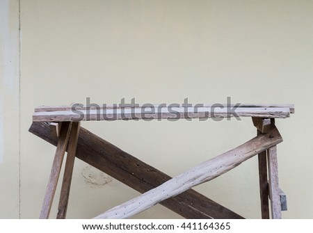 Small wooden scaffold for painting of the rural house wall. - stock photo