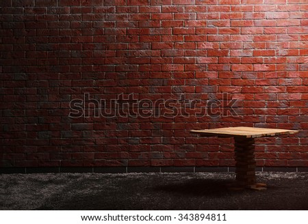 Small wooden table on red brick wall background - stock photo