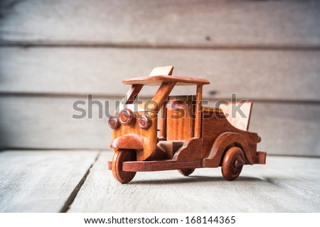 Small wooden toy car - stock photo