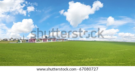 Small workmen's settlement in green field. Sunny Day. - stock photo