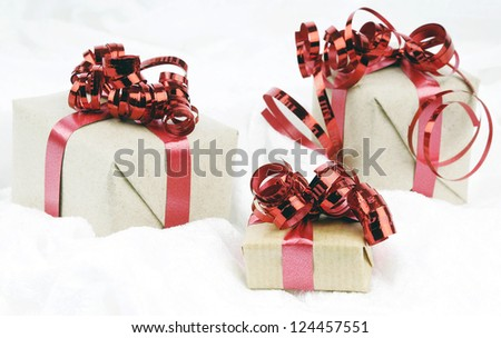 Small wrapped gifts with brown paper and red cords