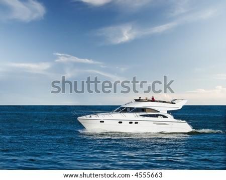 Small yacht cruising in blue sea - stock photo