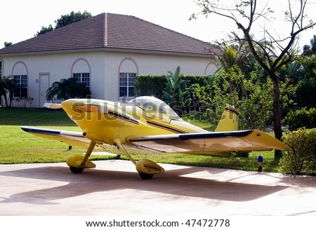 small yellow experimental airplane - stock photo