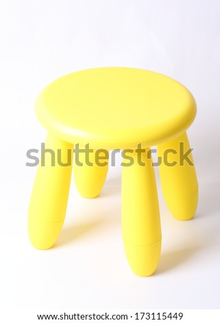 Small yellow plastic stool for kids isolated on white - stock photo