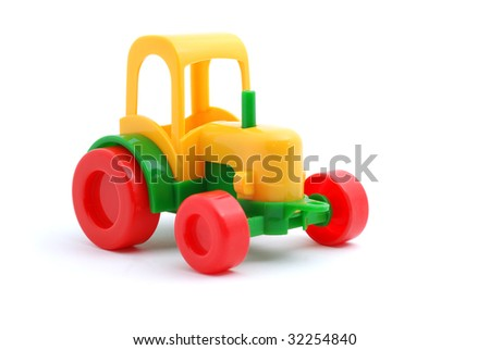 Small yellow toy tractor isloated on white - stock photo