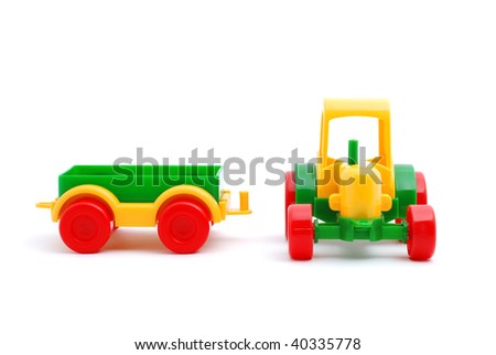 Small yellow toy tractor isolated on white