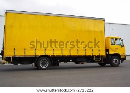 Small yellow truck - stock photo