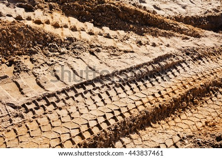 smaller sand with tire tracks in construction