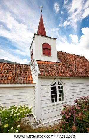 Smallest church in Scandinavia - Undredal stavkyrkje - stock photo