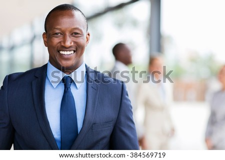 smart african american business man in modern office - stock photo