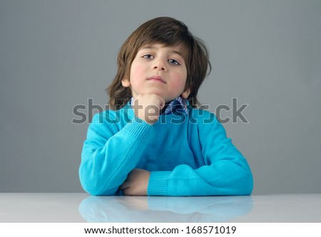 smart beautiful kid thinking against grey background