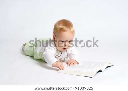 smart blond baby reading a book - stock photo