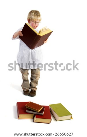 Smart boy is reading thick books for studying - stock photo