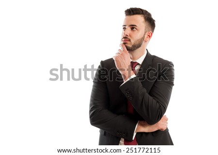 Smart business man thinking - stock photo