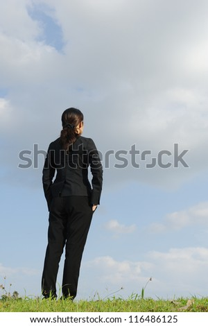 Smart business woman plan for success and blue sky