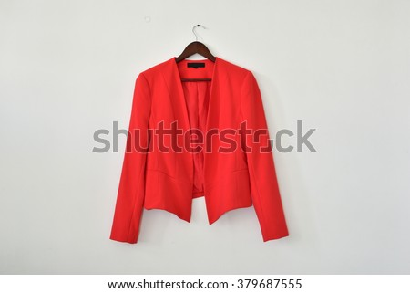 Smart business women's blazer on a hanger isolated on white wall background, with lot of empty space for text  - stock photo