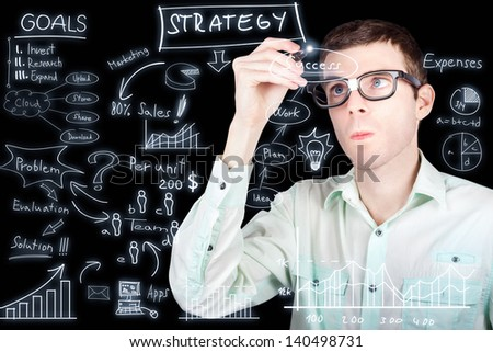 Smart businessman drawing upon social statistics and graph data when planning and implementing a financial growth expansion strategy for modern business success