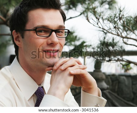 Smart businessman in a suit and tie - stock photo