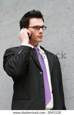 Smart businessman makes a phone call - stock photo