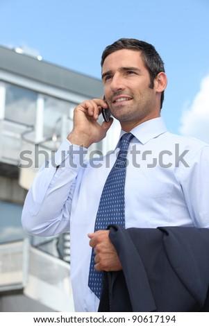 Smart businessman on phone - stock photo