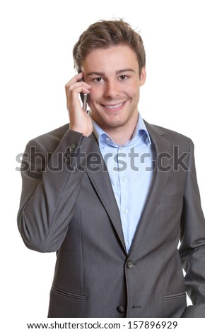 Smart businessman talking at phone  - stock photo