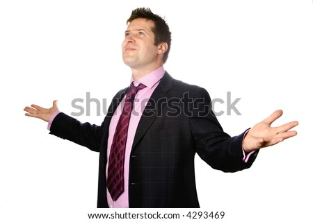 Smart businessman with both arms wide open looking up envisioning a bright and positive future, isolated. - stock photo