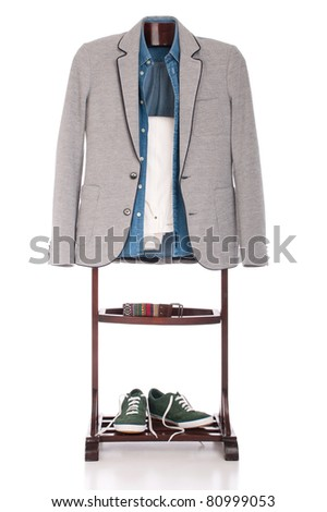 smart casual man dressing for a celebration, event, wedding or night-out on a wooden hanger (shirt, jacket, trousers, belt and stylish sport shoes) isolated on white background
