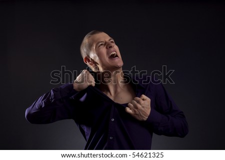 smart casual man screaming and ripping his shirt
