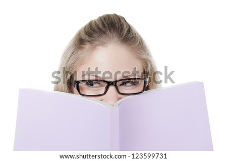 Smart Caucasian woman covering her face with a book - stock photo