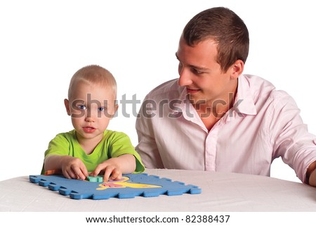smart dad and his son play at table