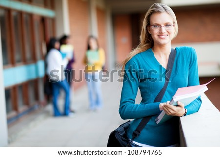 smart female college student on campus - stock photo