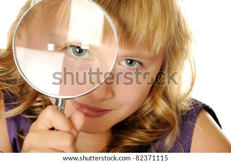 Smart  girl with magnifying glass, isolated on white