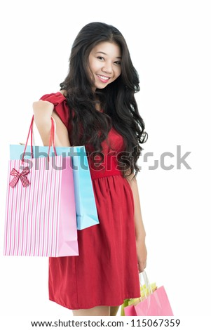 Smart girl with purchases - stock photo