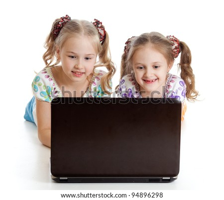 smart girlfriends smiling and looking at the laptop - stock photo