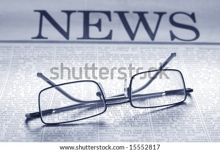smart glasses on newspaper page. top news - stock photo