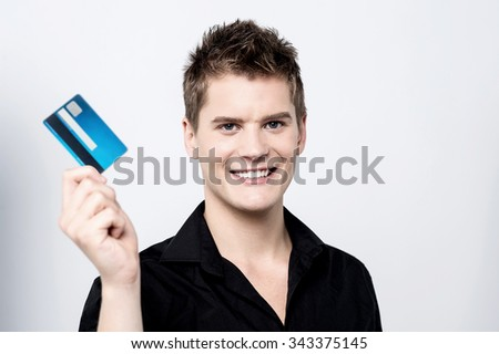 Smart guy showing credit card