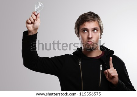 Smart guy with lightbulb having an idea - stock photo