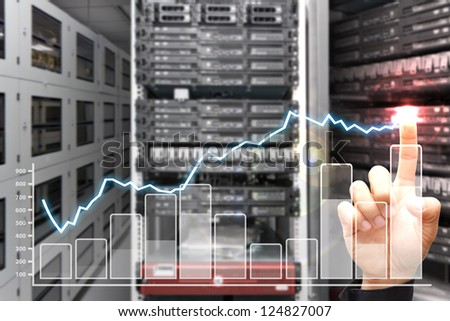 Smart hand press on graph report in data center room