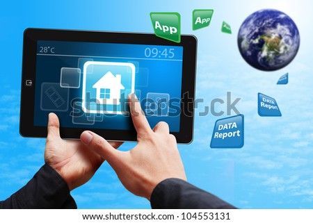 Smart hand press on House icon on tablet pc : Elements of this image furnished by NASA